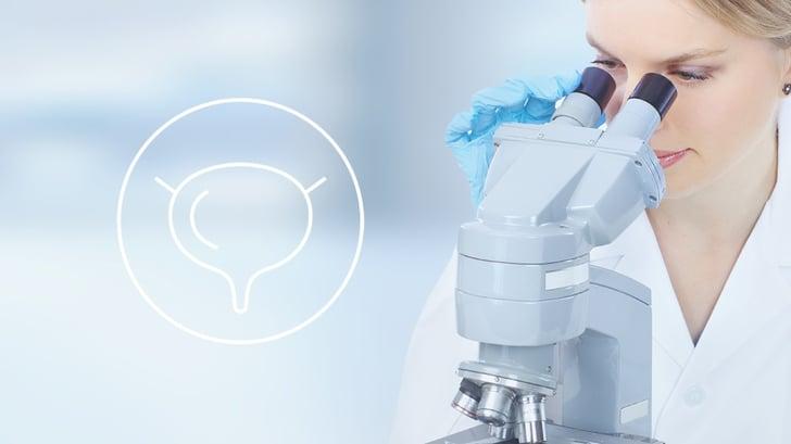 Wellspect Science Alert Healthcare Professional using microscope